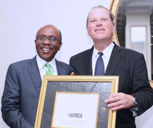 CBN GOVERNOR AWARD IN US 1: The Governor, Central Bank of Nigeria (CBN), Mr. Godwin Emefiele (left) receiving the 2017 Forbes Best of Africa Innovative Banking Award from the President of Forbes Customs Emerging Markets, Mr. Mark Furlong at a dinner held at the Willard Intercontinental, Washington, on the sidelines of the Annual Meetings of the World Bank and the International Monetary Fund (IMF) in Washington DC Thursday, October 12, 2017. PHOTO; SUNDAY AGHAEZE
